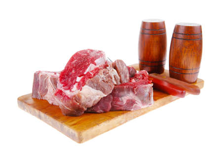fresh raw beef steak entrecote fillet ready to prepare on cut board with cutlery and castor isolated over white background photo