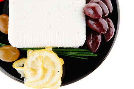 mediterranian: image of feta cheese and olives on black