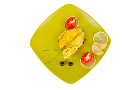 sunfish: roast sea sole fish fillet served on bread with tomatoes,olives and chives on green plate isolated over white background