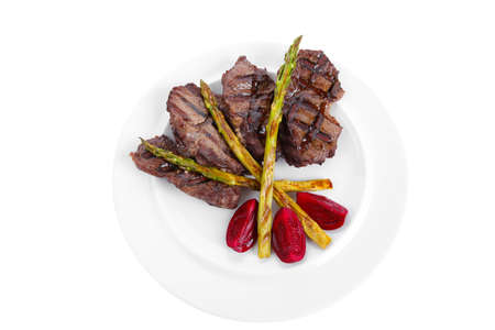 grilled red beef pork meat bbq steak fillet with asparagus and hot pepper served on plate isolated on white background photo