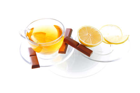 sweet health dessert - light green tea with lemon and chocolate strips isolated over white background photo