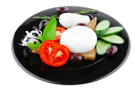 fresh white mozzarella cheese with vegetables on black photo