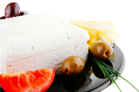 image of feta cheese and olives on black photo