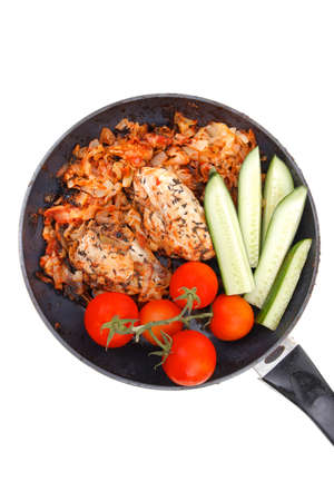 meat grilled chicken fillet cooked with vegetables on ceramic pan isolated over white background photo