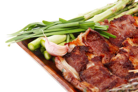 hot lunch of fresh beef meat roasted ribs with asparagus and tomatoes isolated over white background photo