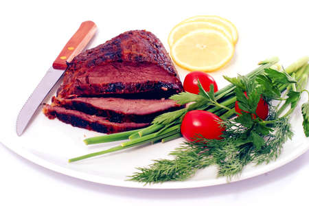 roast beef meat steak chunk with asparagus dill and cherry tomatoes on white plate photo