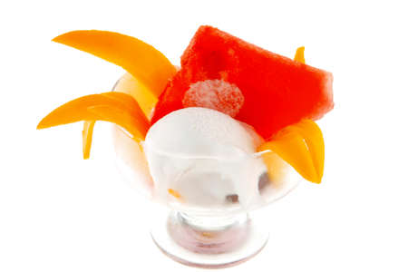small transparent glass cup with ice cream and tropical fruits isolated on white  photo