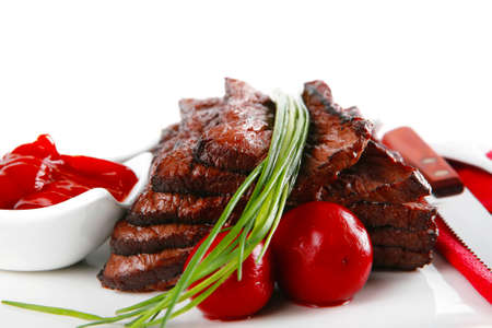 roast red beef meat fillet with red hot pepper with ketchup mayonnaise and mustard on plate isolated on white  photo