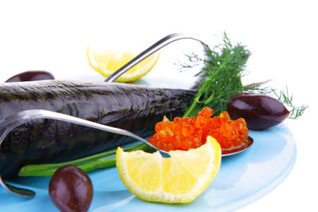 diet food - red caviar and smoked mackerel fish with lemon and dill on blue plate isolated over white background photo