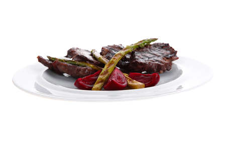 grilled red beef pork meat barbecue steak fillet with asparagus and hot pepper served on deep plate isolated on white background photo