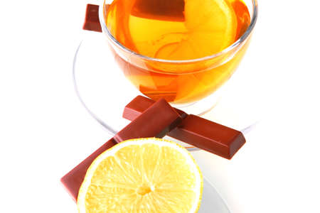 sweet health dessert - light green tea with lemon and chocolate strips isolated over white  photo