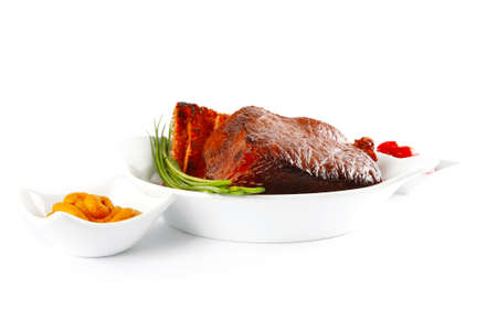 served beef meat fillet mignon with spices and toasted bread isolated on white background photo