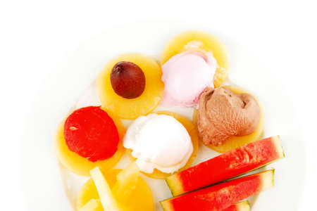 watermelon plum and slice of pineapple and chocolate and fruit ice cream on white plate isolated over white  photo