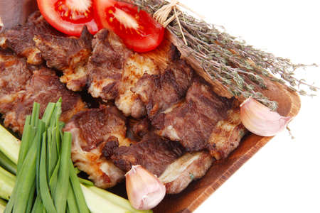 meat grilled: beef meat grilled ribs with asparagus and tomatoes isolated over white  Stock Photo