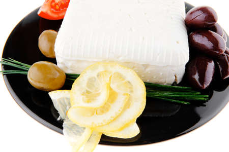 image of feta cube on black plate photo