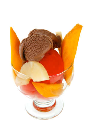fresh raw  tropical fruits with chocolate ice cream in big glass isolated on white  photo
