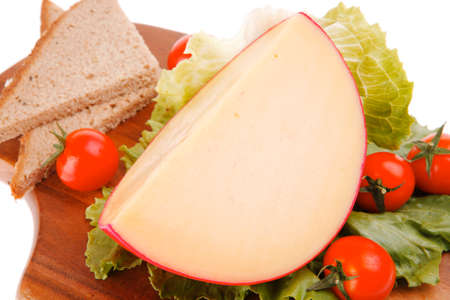 image of cheese with tomatoes with lettuce leaf photo