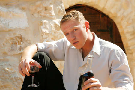 young happy white caucasion man taste and enjoy red wine outdoor in in countryside photo