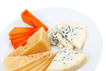 sustained: aged parmesan roquefort and gruyere chops delicatessen cheeses and slices on plate isolated over white background