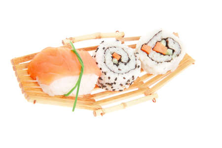 Japanese Cuisine - Maki Roll with Deep Fried Vegetables inside with Sashimi made of Smoked Salmon and Eel. on wooden boats . isolated over white background photo