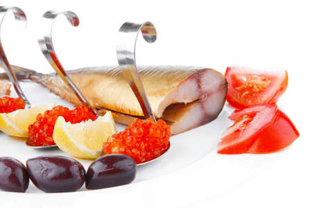 diet food - red caviar and smoked mackerel fish with lemon tomatoes and bread on white china plate isolated over white background photo