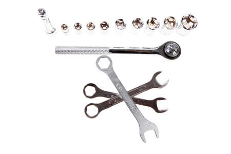 set of tools: ratche handle with bushs adjustable wrench and spanners photo