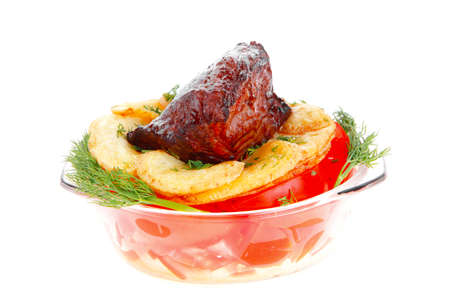 fresh roast beef meat chunk in transparent bowl over baked potatoes and tomatoves served with fill isolated over white background photo