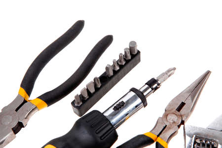 set of tools include adjustable wrench pliers bit driver and bits photo