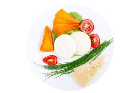 fresh aged cheese : parmesan roquefort and gruyere with soft feta on plate with isolated over white background photo