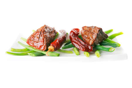 served grilled beef veal fillet entrecote on a white plate with peppers and green peas on long plate isolated on white background Stock Photo - 28559213