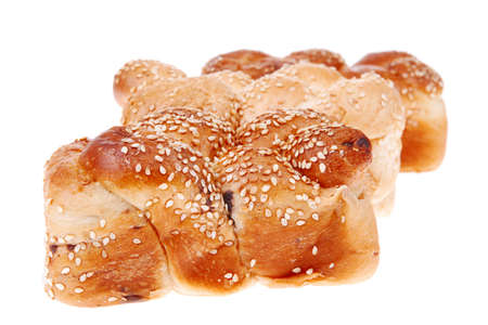 hot bun of light wheat bread topped by sesame seeds isolated over white background photo