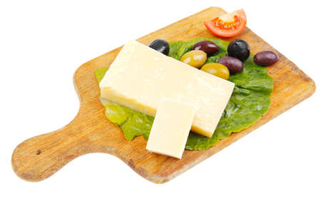 cheese platter: yellow edam cheese on wooden platter with olives and tomato isolated over white background Stock Photo