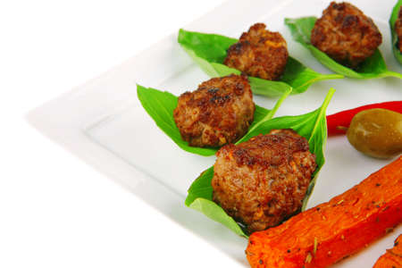 grilled french cutlets served on basil leafs photo