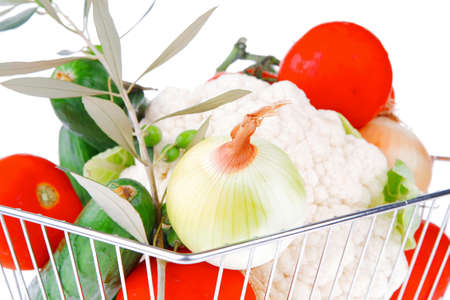 market basket filled with vegetables on white photo