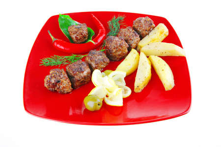 beef meat balls with peppers and potatoes photo