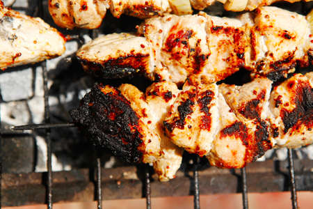 ready to eat smoked fresh hot grilled chicken shish kebab barbecue on grid over charcoal photo