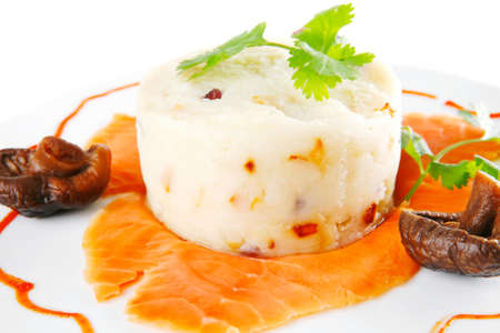 smoked salmon served with mashed potatoes on white photo