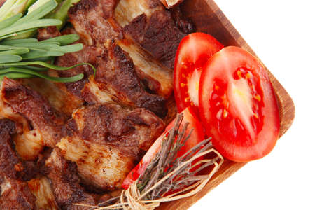 beef meat grilled ribs with asparagus and tomatoes isolated over white background photo