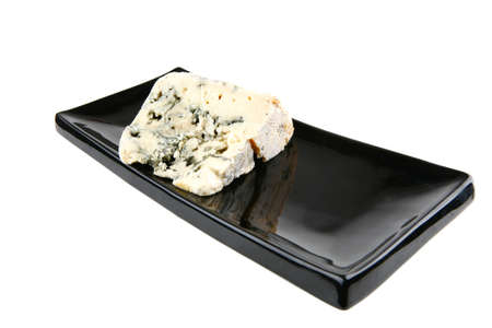 roquefort: french roquefort soft cheese on black plate Stock Photo