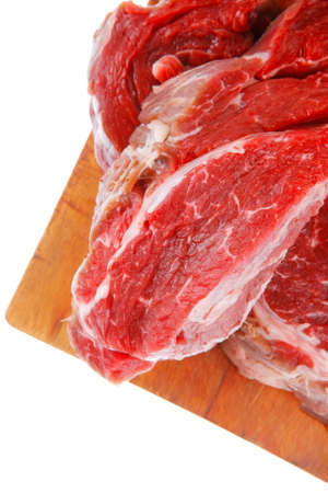 raw fillet mignon on cutting board prepared for roasting photo