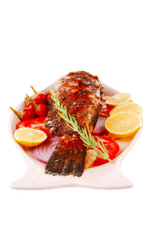 sunfish: main course: whole fryed sunfish on plate with lemons and peppers