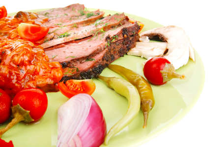 corned beef on plate with vegetables isolated over white photo