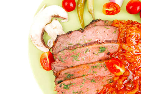 corned beef on plate isolated over white photo