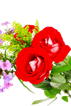 season specific: flowers : big bouquet of rose and pansy flowers with green grass isolated over white background Stock Photo