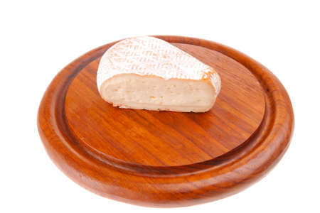 image of cheese on red wooden plate photo