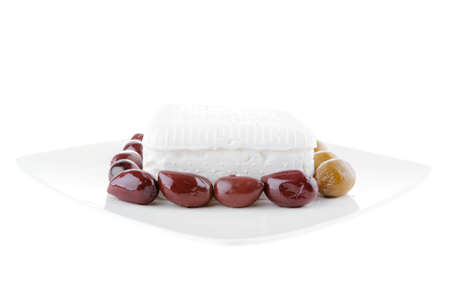 image of soft feta cube with rare olives photo