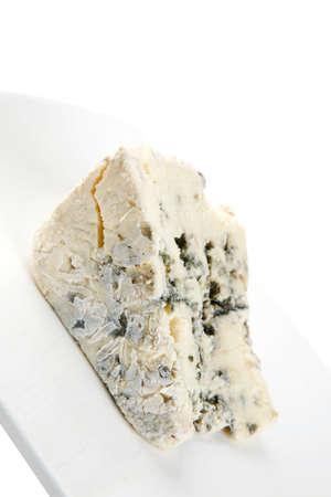 stilton: soft moldy stilton cheese on white dish