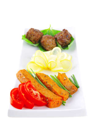 roasted cutlets with potatoes and tomatoes on white photo