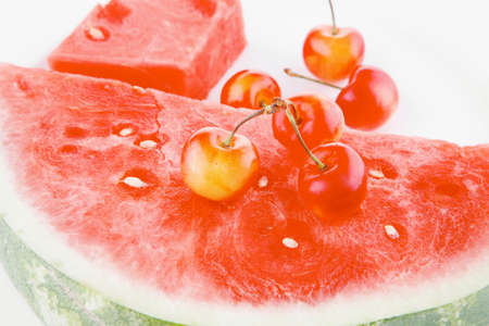 pulpy: fresh raw watermelon and cherry on white plate Stock Photo