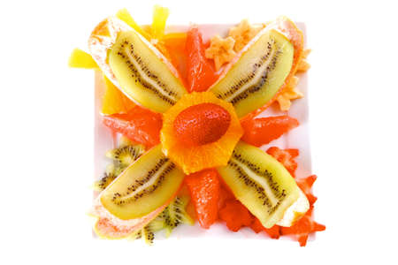 fruit eater: raw tropical fruits served on white plate Stock Photo